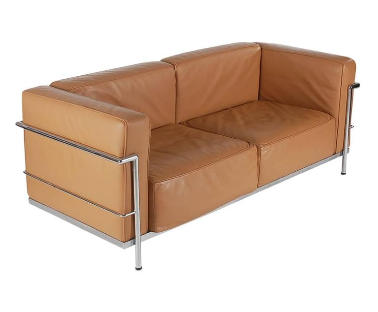 Mid Century Modern Pair Of Tan Leather Sofas In The Style