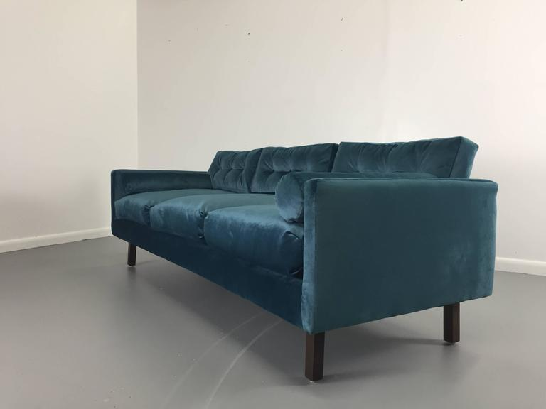 This beautiful 1960s Harvey Probber sofa has been completely refinished and reupholstered in a lovely peacock colored velvet and fitted with down or foam filled pillows.