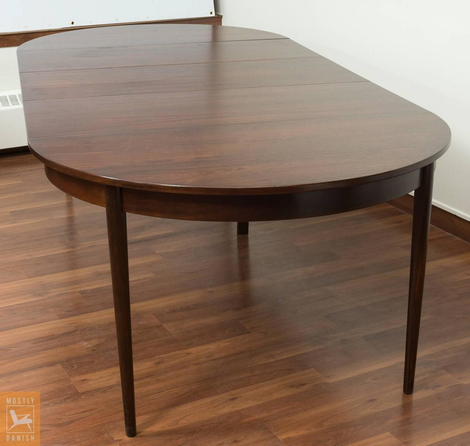 round dining table veneered rosewood with extensions for
