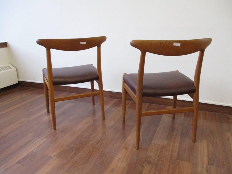 A pair of Hans Wegner Heart chairs in white oak and reupholstered leather seats. Produced by CM Madsen in 1953.