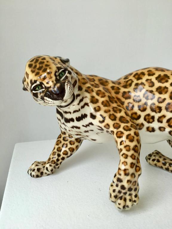 The leopard Zola from a series of Art Nouveau fine porcelain figurines modeled by Hans Behrens in 1904 for Porzellan Manufaktur Nymphenburg. In production since 1904, this lifelike piece dates to the 1960s.