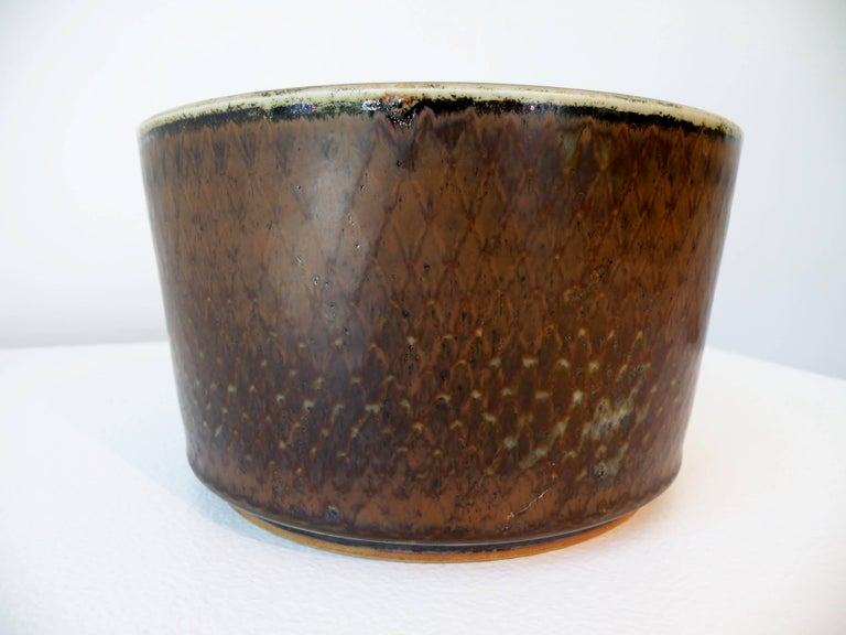 One of a kind studio pottery cylinder bowl personally created by Carl Harry Stalhane with his handwritten C.H. Stalhane incised signature to base. Geometric incised scale and rich organic modernist glaze decoration. Dated 1960, made in Sweden for