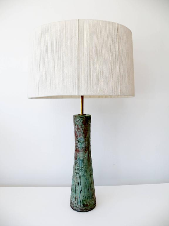 Fine 1950s organic modernist unsigned Studio Pottery table lamp with a sgraffito decoration of abstracted female figures. Body of lamp approximate 18