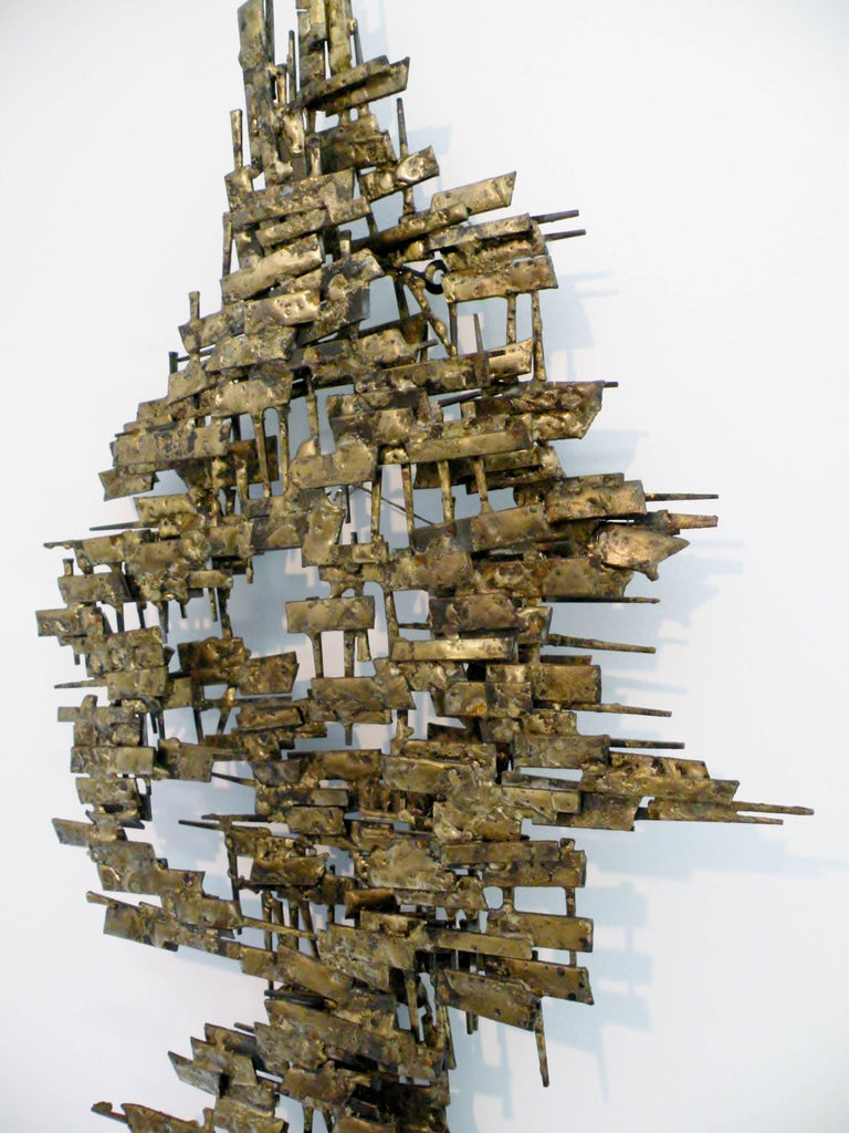 Abstract 1960s era Brutalist welded metal and nail with gilt highlights wall sculpture. 46