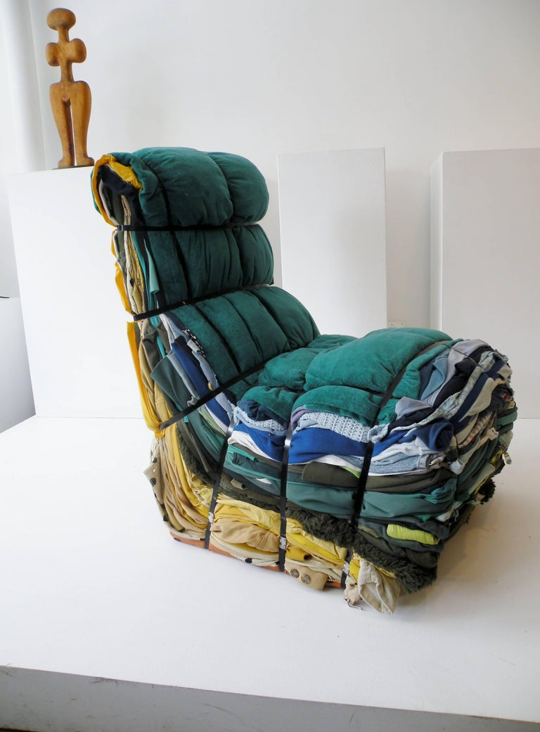Tejo Remy (Dutch b. 1960) designed rag chair for Droog design and produced in 1991. Iconic design each individually hand crafted of 100+ pounds of clothing rags bound with steel straps.