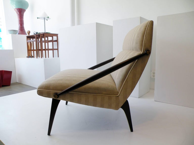 An elegant and rare Italian lounge chair. Sculptural cantilevered form often attributed as a design by architect Gio Ponti. This lounge chair manufactured by M. Singer and Sons, restored and newly reupholstered with backed silk.