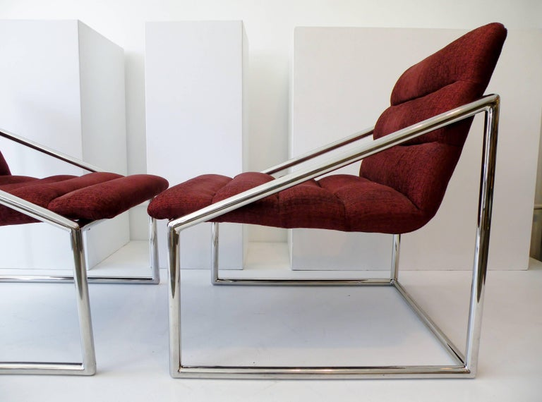 A sculptural pair of 1970s era cube form sling club lounge chairs. High quality tubular chromed steel construction from an unknown maker. Each with original silk upholstery and approx. 28.25