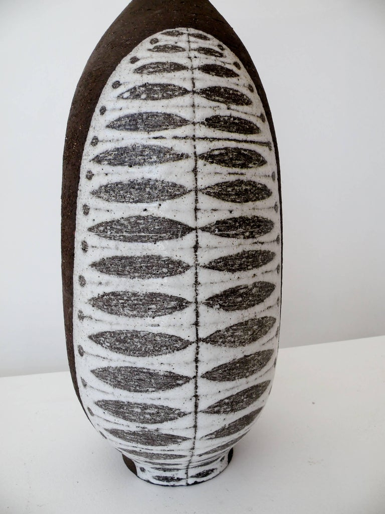 "Danish modern Thomas Toft art pottery ceramic vase. Large 18"" tall vase with bulbous and waisted form. A Scandinavian inspired graphic decoration of white glaze on unglazed brown clay body to both sides. Signed to base."