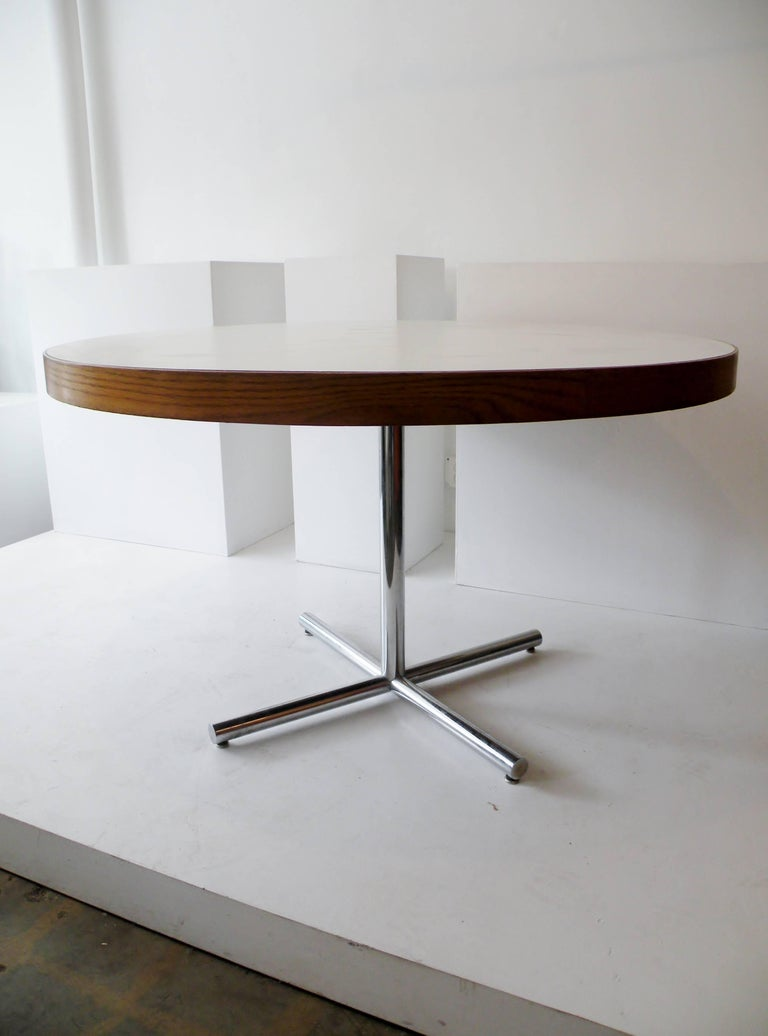 Italian round pedestal table. Chrome, wood and melamine.