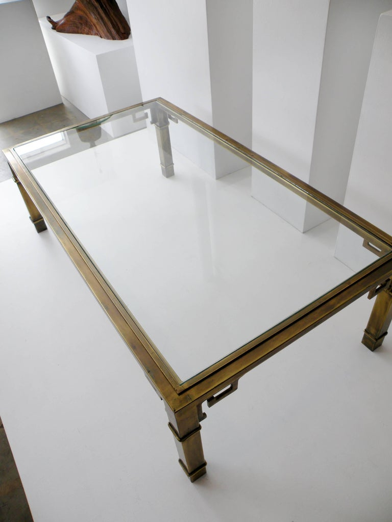 Iconic 1970s patinated brass rectangular coffee table with a Greek Key chinoiserie motif from the renowned luxury workshops of Mastercraft Furniture.