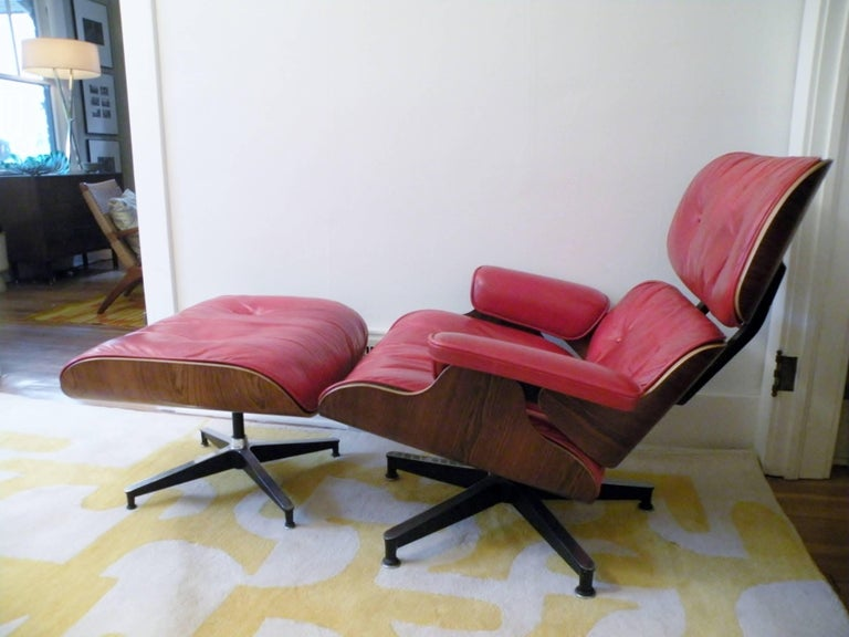 "An important 1960s custom order Charles & Ray Eames Herman Miller 670/671 lounge chair with matching ottoman with lipstick red leather and rosewood shells. Chair measures 32"" high, 34"" wide, and 35"" deep, ottoman 17"" high,"