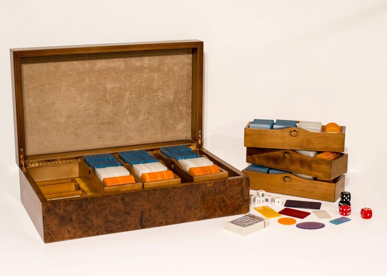 Luxurious 1970s velvet lined briar wood cases opens to reveal a Florentine Italian poker game set. Each case fitted with five trays and compartmentalized base holding approximate 685 unmarked pearlized or iridescent acrylic European style poker
