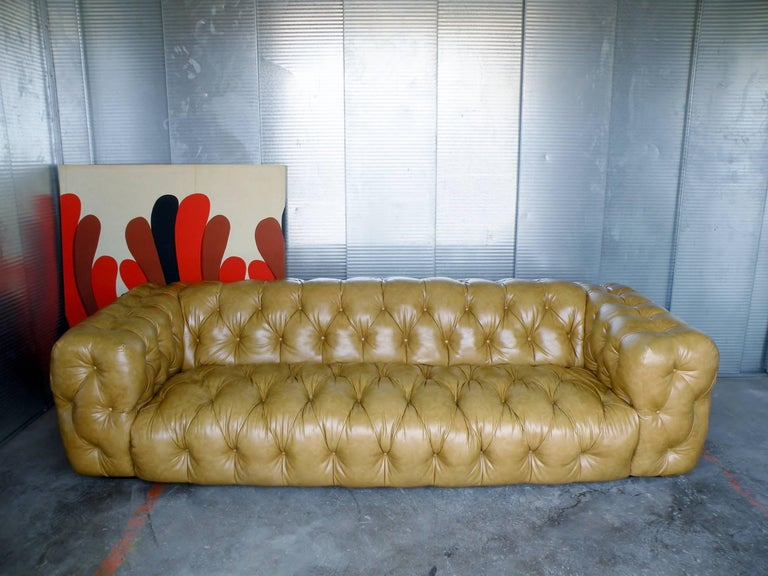 Important and rarely seen 1970s era Milo Baughman for Thayer Coggin tuxedo style button tufted sofa. Modern luxury meets the Classic Chesterfield sofa. Floats on low platform base with all sides and surfaces fully tufted in original soft man-made