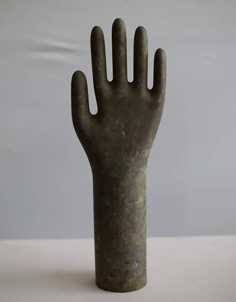 Aluminium glove mold, circa 1940-1950s, stands up on it's own. Great to accessorize a shelf or coffee table. Mount it on a metal stand or hang it on a wall perpendicularly. Could also be used a towel or coat holder.