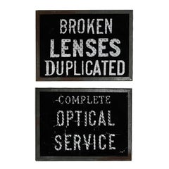 Pair of Early 20th Century Glass Optical Signs, circa 1910-1920