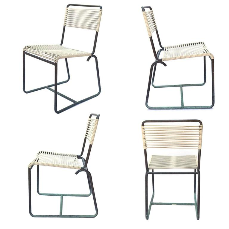 Price is per piece  Set of four bronze Walter Lamb brown Jordan side chairs with beautiful green patina. The chairs have original nylon cording. Two have original Brown Jordan labels, circa 1950s.  Bio: Designer Walter Lamb was experimenting with