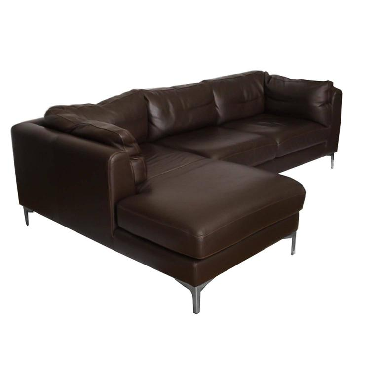 Design within reach sectional sofa in brown leather by Nicoletti. Support cushions are zippered to the frame keeping them in place and upright. Heavy grained leather with chrome feet. Two-seat section and a chaise longue. Easily separated with two