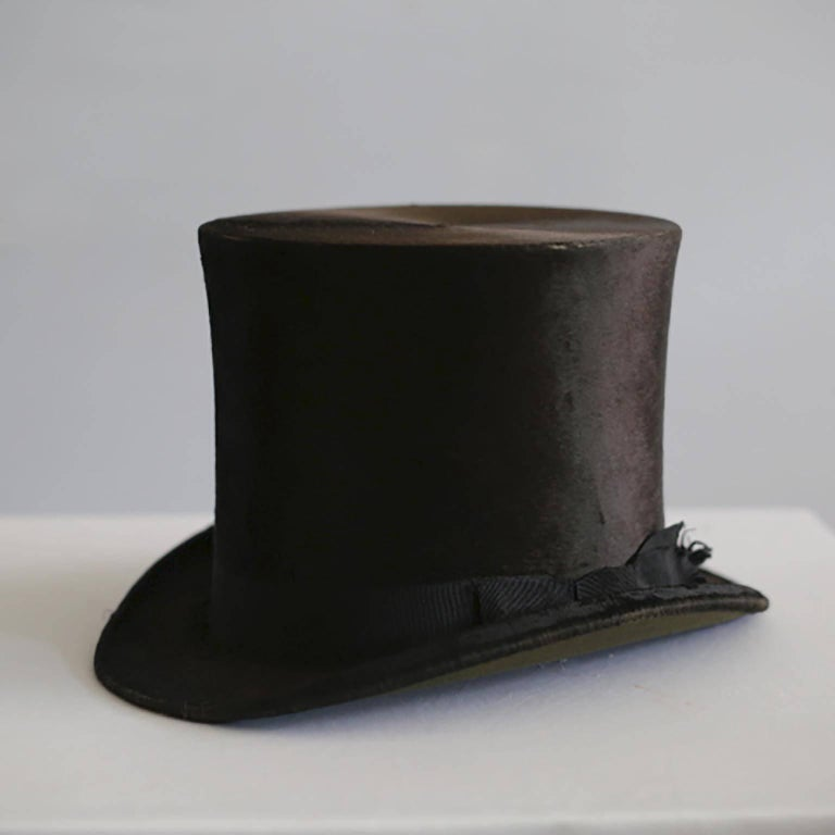 Dunlap and Co. beaver skin top hat and original leather hat box by Collins and Fairbanks. Made in England. 