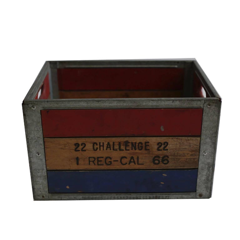 Very sturdy painted wood and steel milk crate.