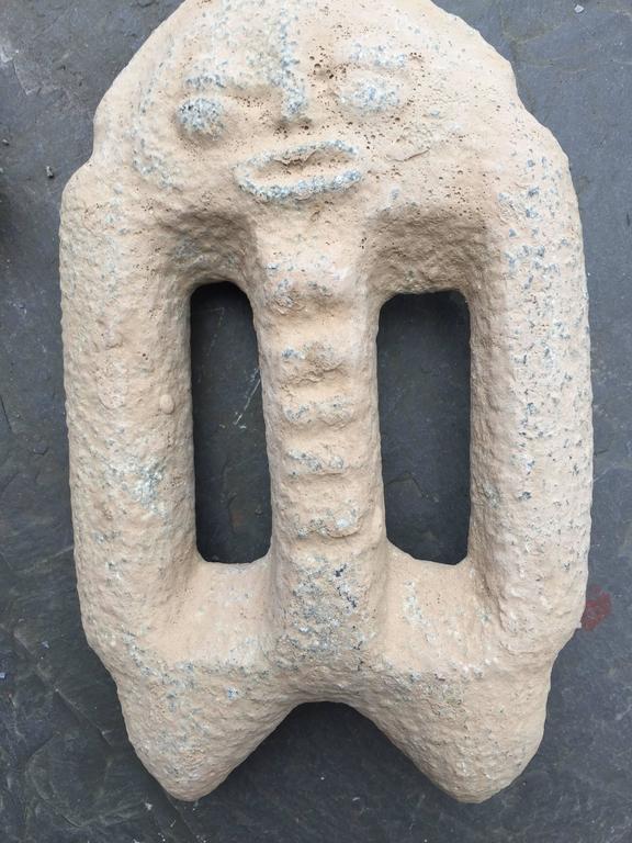 Stone age hand tool group with human effigies crushing