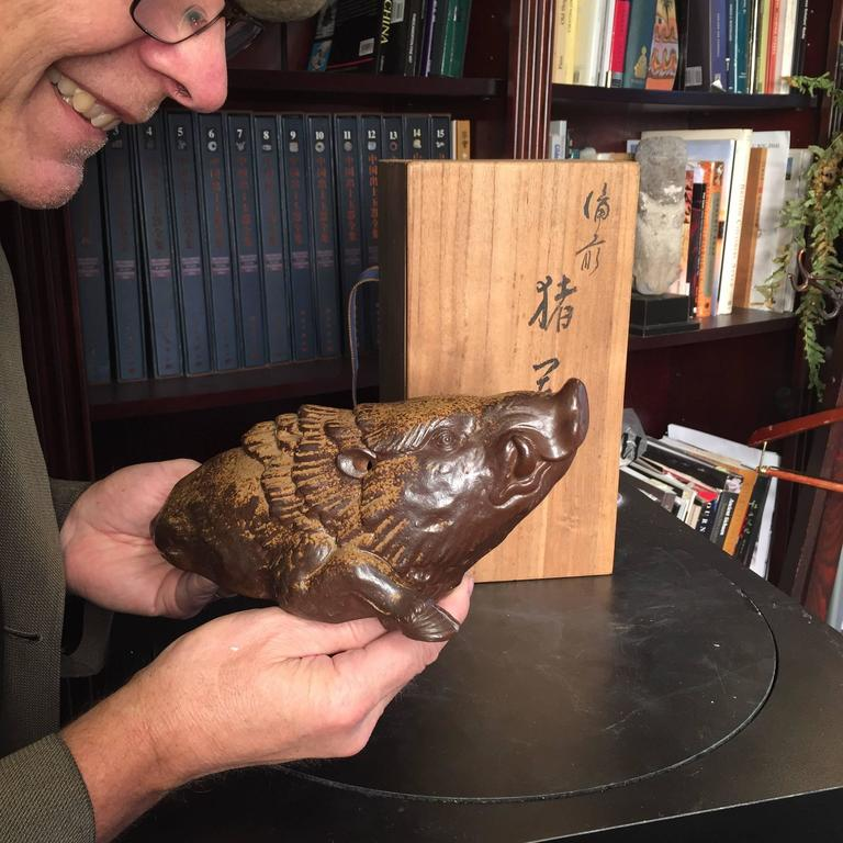 Signed, mint and boxed!  Here's a beautiful and unique way to accent your indoor space with this very unusual treasure from Japan!   This is a finely crafted, realistically finished ceramic effigy of a magnificent charging boar. It is accompanied by