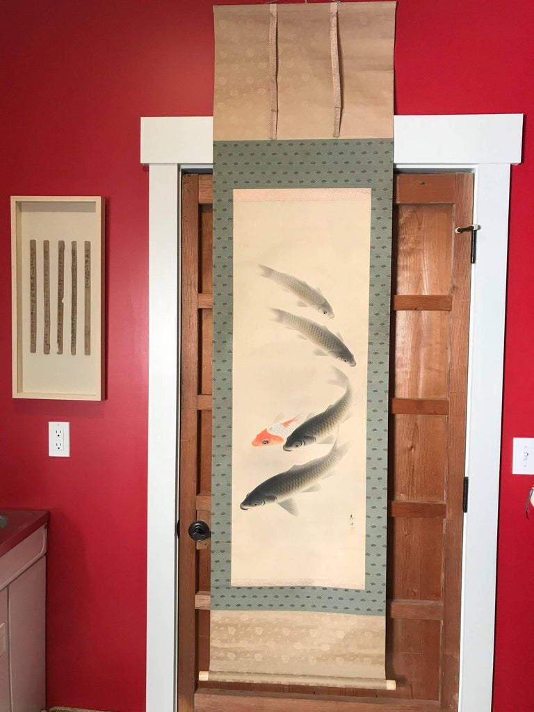 Japan, a swirl of Koi or Carp ripple the waters in this auspicious art composition a hand-painted early signed silk scroll dating to the Taisho era early 20th century. Koi soothe the mind and spirits and reminds us of the important cultural