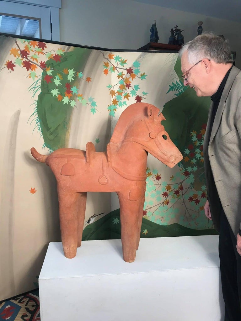 Important ancient Japanese tall Elite Haniwa model horse, Kofun period (593-710 AD)  This large model horse sculpture was crafted in ancient times using a low fired reddish clay and then boldly modeled with saddle, stirrups, bridle, and ornamental