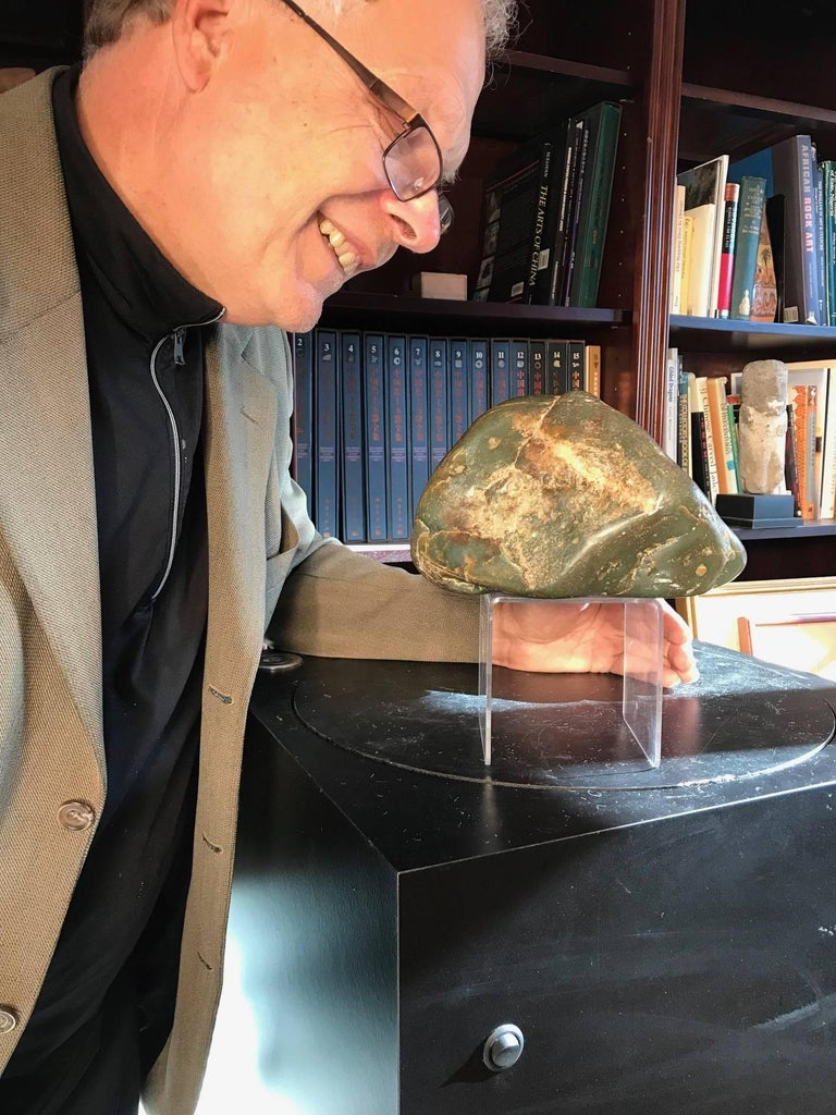 A fine natural Hetien jade scholar rock in boulder form collected from the Khotan region of western China in 1995.  A complimentary black hardwood display base is included.  Dimensions: It measures 5 inches high and 8 inches width  Quality: Fine