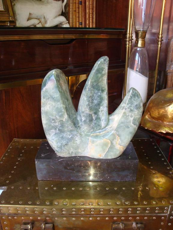 This is a abstract stone and marble sculpture from the 1970s by A. Schmetter.