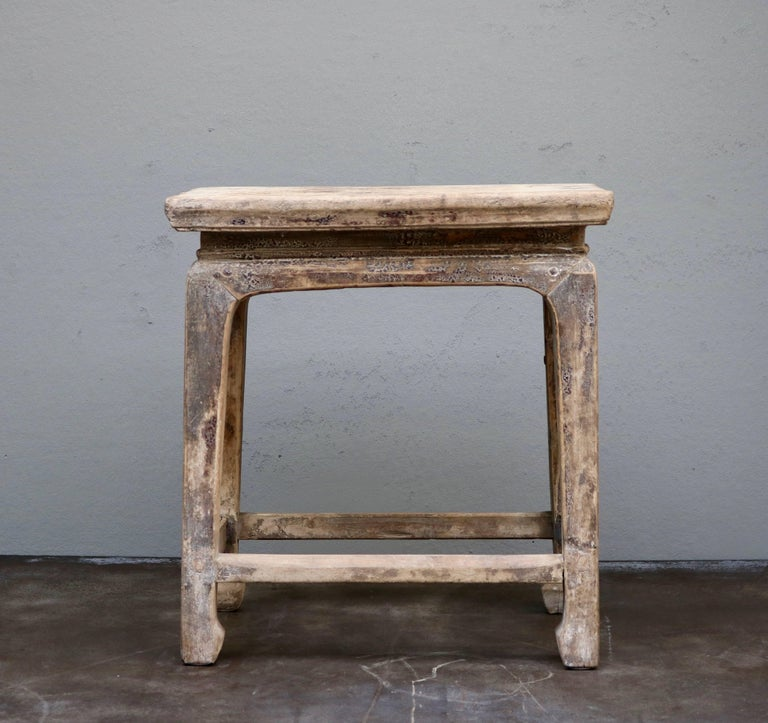Stool made in ancient Chinese elmwood from the 19th century. Originally from the Shanxi Province in China.