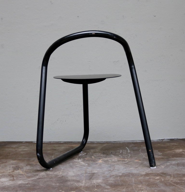 Notice that the chairs are sold as a pair.  These café chairs by the Danish designer, Erik Magnussen, are made of aluminum. The model is characterized by the fact that the chair legs, backrest and seat make up a coherent course.