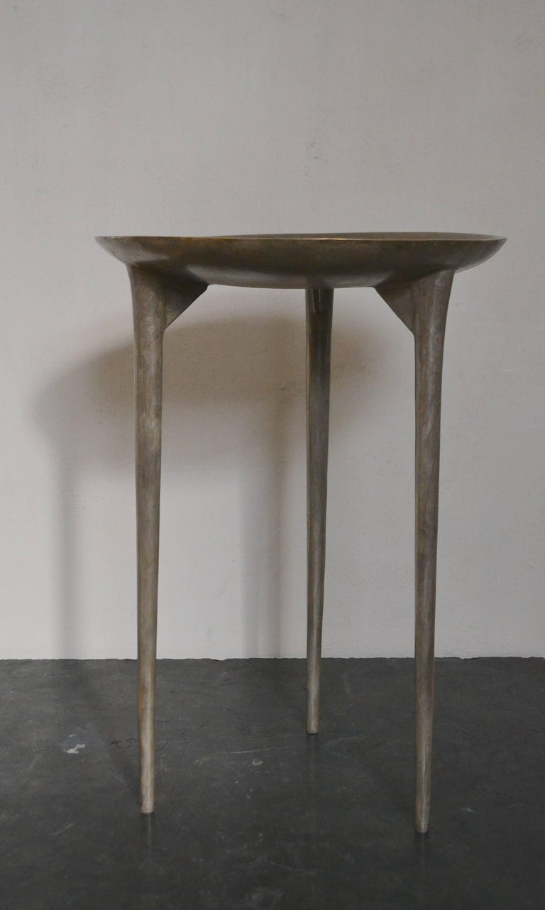 Rick Owens 'Tall Brazier' three-legged table in solid bronze with nitrate finish.