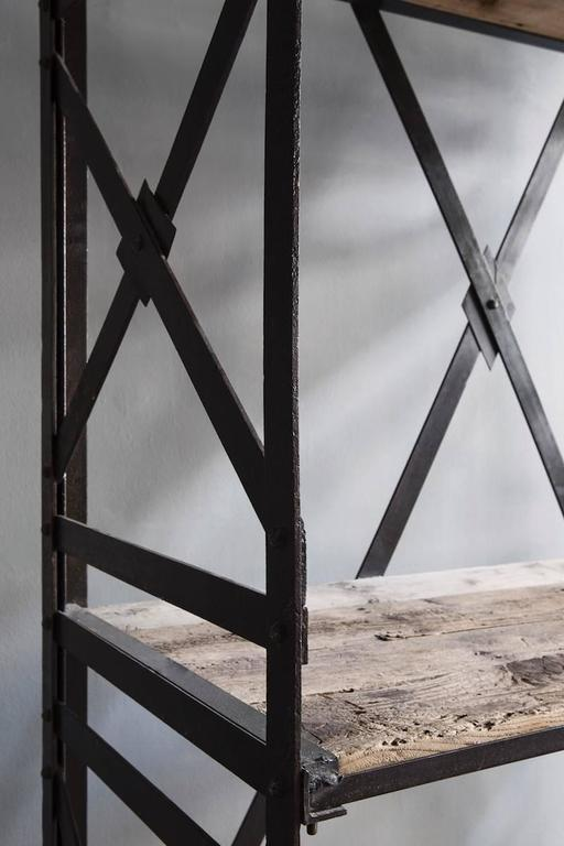 Old Belgian industrial bookcase made from elm wood and with an iron frame.