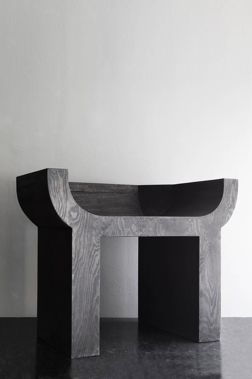 Curial chair designed by Rick Owens, made in black stained plywood. This chair is number 24 of the limited edition of 25. Please note: This item is located in our New York City Studio and will be shipped from there.