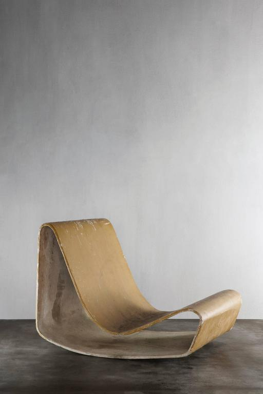 Iconic Mid-Century Modern chair with lovely patina designed by Willy Guhl, made of fibrated concrete.