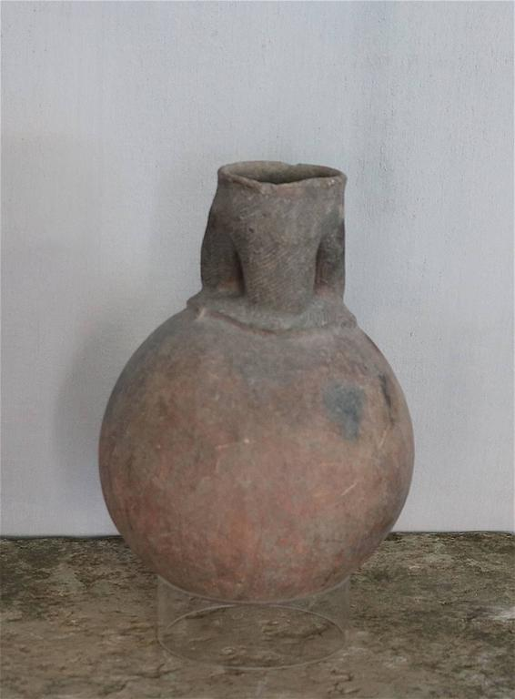 Lovely old clay pot from Nigeria originally used for sacrifices. The pot originates from a private French collection.