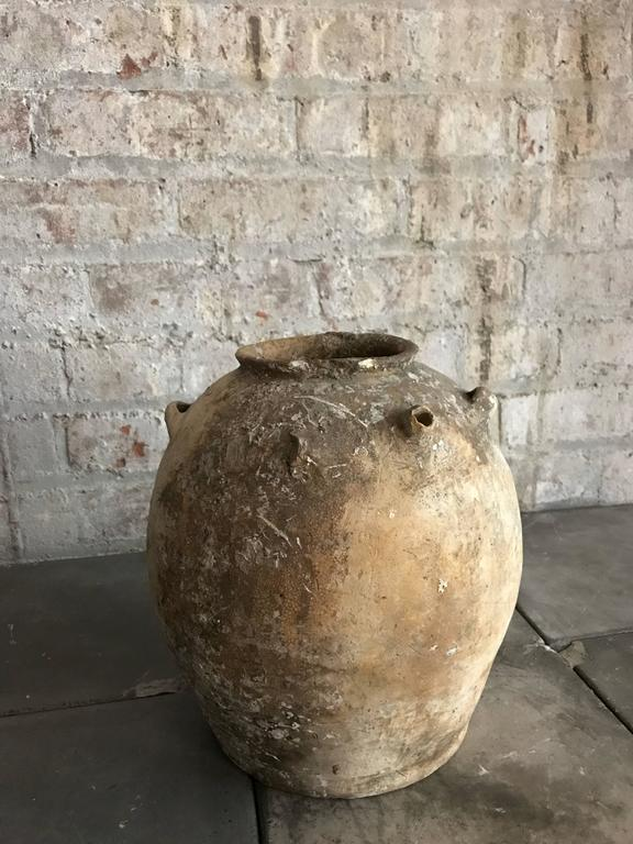 Old Khmer honey jar.