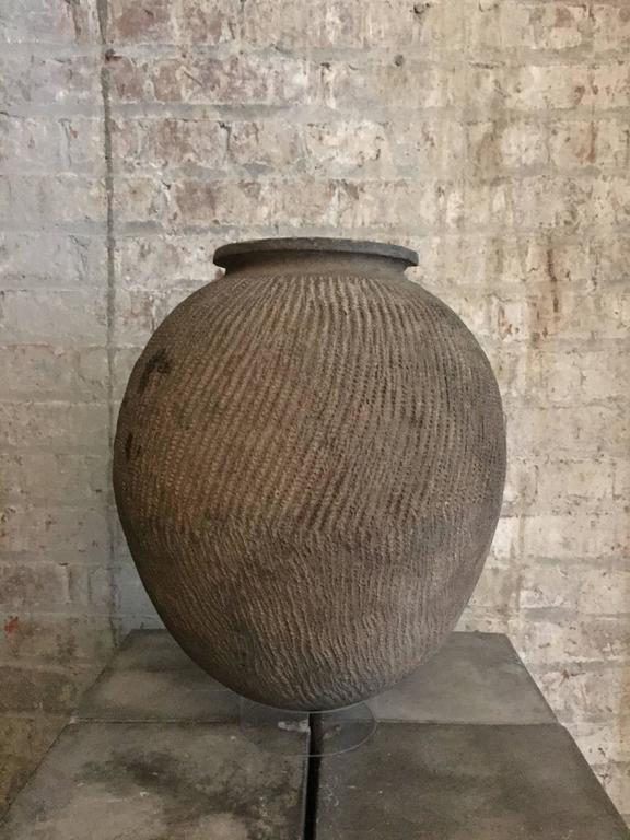 Lovely old clay pot from Nigeria. Please note: This item is located in our New York City Studio and will be shipped from there.