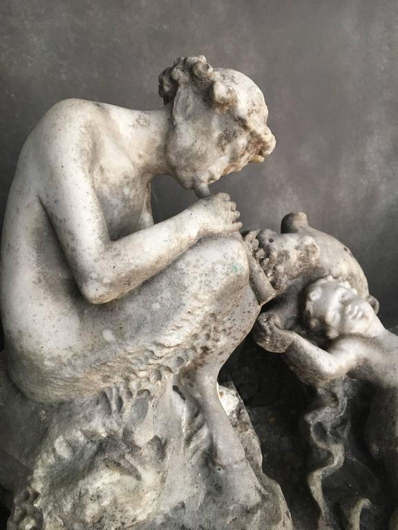 Italian marble sculpture from the late 18th century. A faun is showing in the middle. The sculpture has a beautiful patina with old broken-off pieces. Please note: This item is located in our New York City Studio and will be shipped from there.
