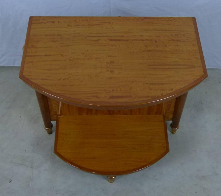 Pair of bedside or end sofa tables composed of two lemon trays, connected by a vertical lemon tree background. A hook supports the top shelf. They rest on three sheathed feet finished by gilded wooden hoofs. These tables have been completely