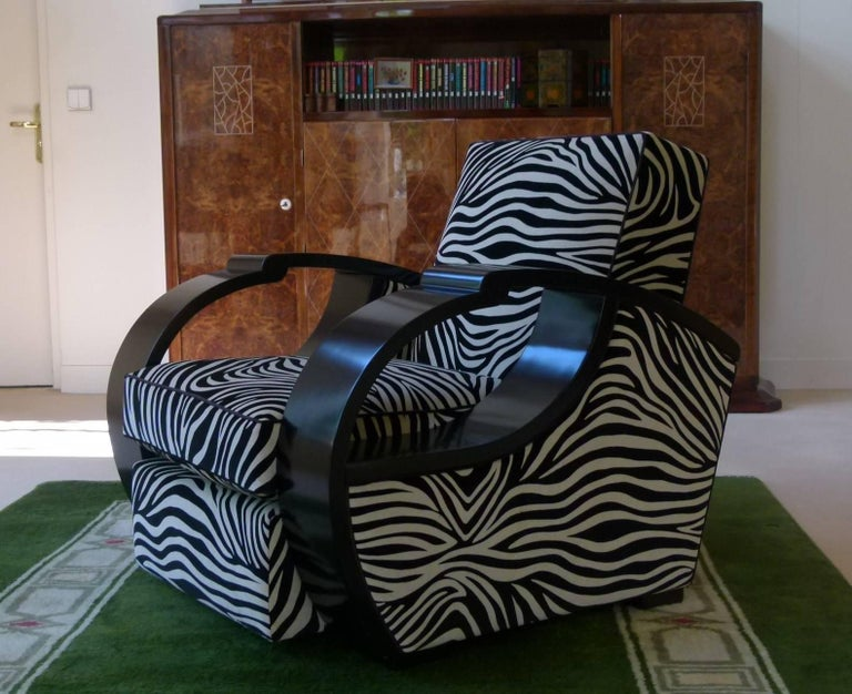 Large pair of armchairs in satin black lacquer, composed of wide black lacquered armrests. Zebra patterned velvet fabric. 1930s French Art Deco work. These armchairs have been completely restored, lacquered and recovered. Perfect condition.