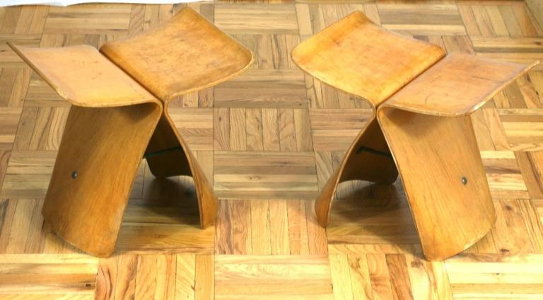 Pair of period Sori Yanagi butterfly stools sold in original condition. Molded plywood with veener. Structurally sound, with some discoloration and later varnishing, 1950s, Japan.