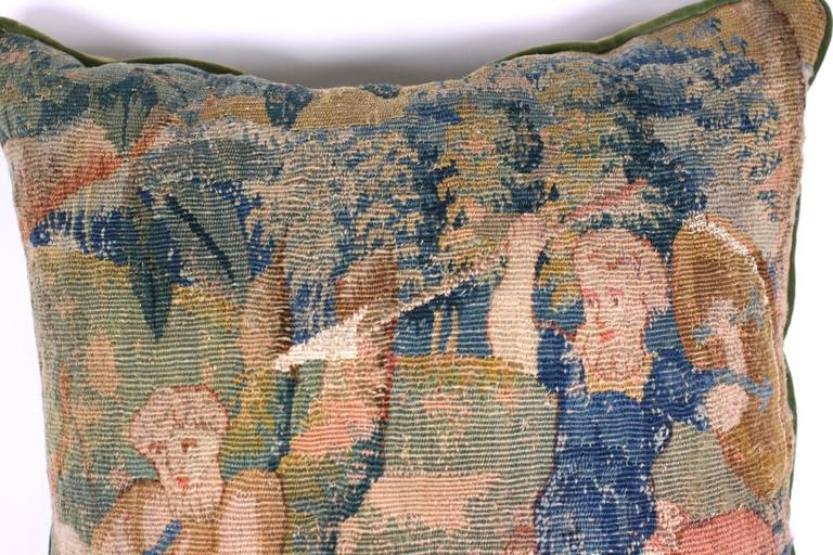 Aubusson tapestry cushion of battling Satyrs, likely created from a textile from the late 18th century. Cotton velvet backing with piping. Excellent condition. Measures: 20