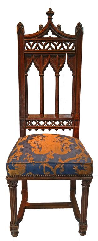 Hand-carved oak, recently reupholstered.