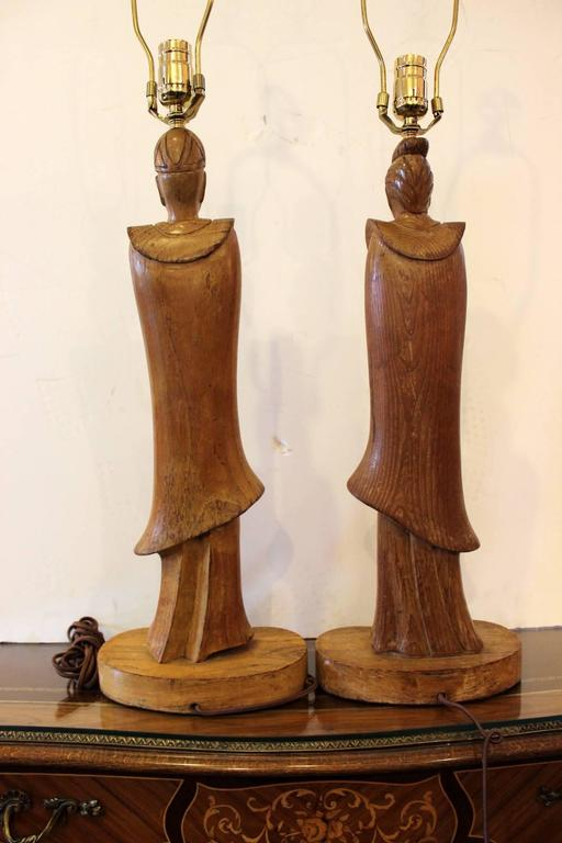Wood Pair of James Mont Style Oriental Figure Lamps For Sale