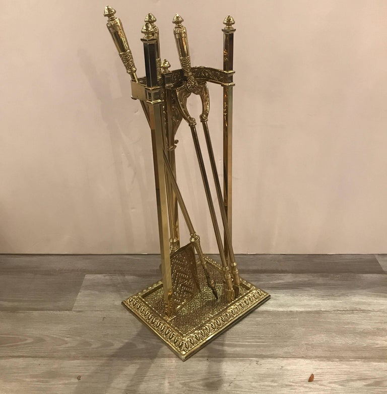 Fireplace stand and a set of three matching tools, early 20th century, elegant style and nicely polished.