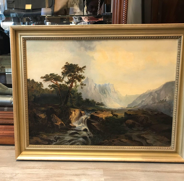 Oil on canvas bucolic scene with elk. Artist singed and dated. The canvas had been re-stretched and relined and is in excellent condition in a silver gold gilt more recent wood frame. The painting is European and probably Austrian.