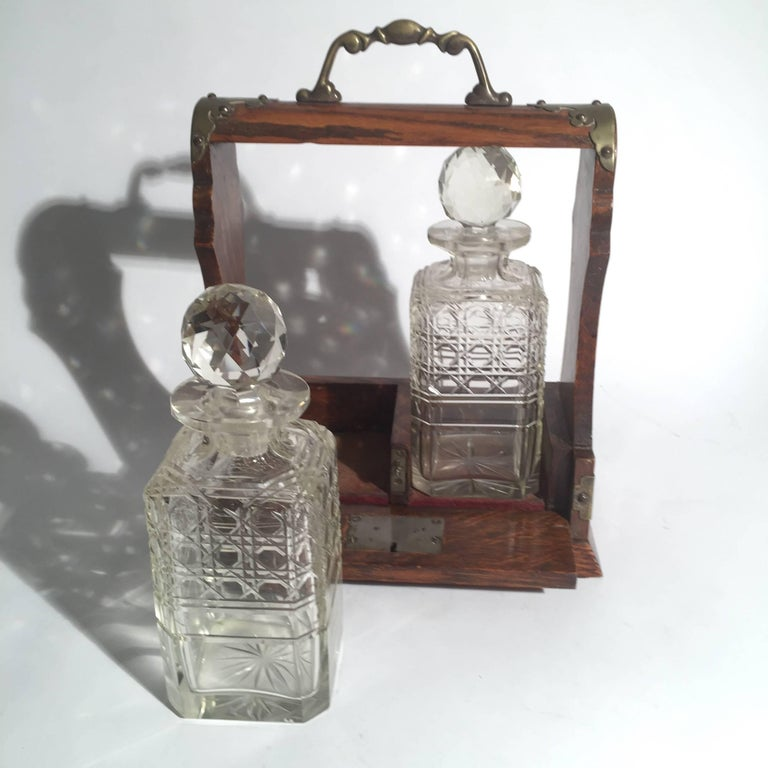 English Oak Tantalus with Two Cut Glass Decanters In Good Condition For Sale In Lambertville, NJ