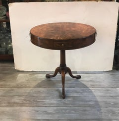 A Pair or round walnut peristalsis side table