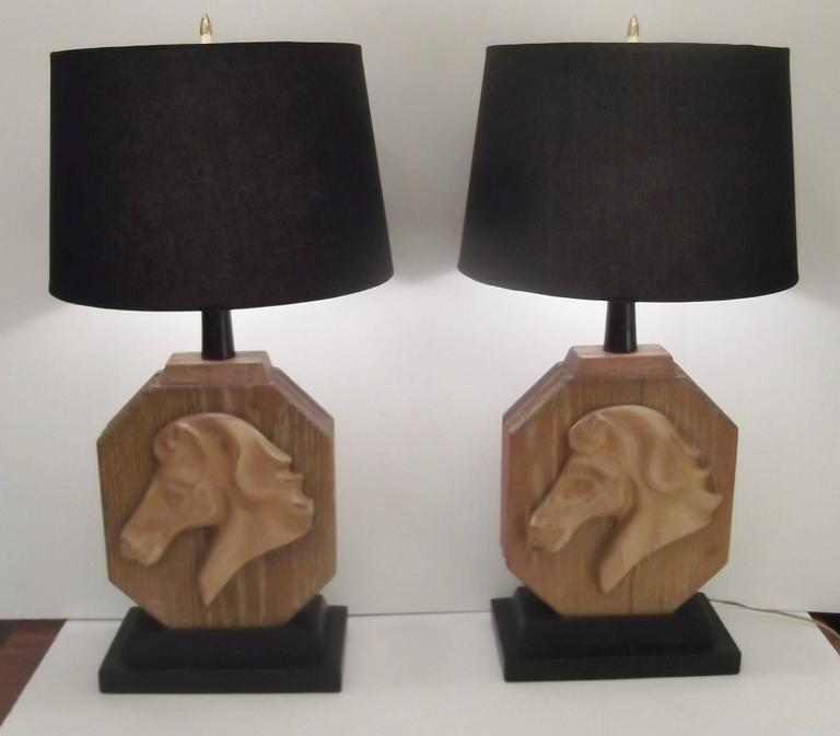 A pair of limed oak Heifetz carved horse lamps.
